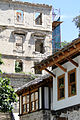 Facades with War-Damaged Building at Rear - Mostar - Bosnia and Herzegovina.jpg