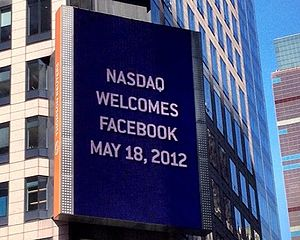 Facebook - Billboard on the Thomson Reuters building welcomes Facebook to NASDAQ, 2012