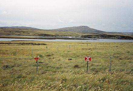 Although some minefields have been cleared, a substantial number of them still exist in the islands, such as this one at Port William, East Falkland. Falklands-Minefield.JPG