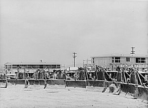 Federal Works Agency - Defense worker housing at Kearney-Mesa, California, being built by the Public Buildings Administration of the Federal Works Agency in May 1941. Photograph by Russell Lee.