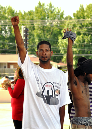 Black Power - Protester raises his hand in black power salute, Ferguson, Missouri, 15 August 2014