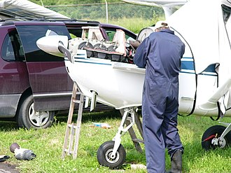Aircraft maintenance - Field maintenance on a Cessna 172 being conducted from a van used to carry tools and parts