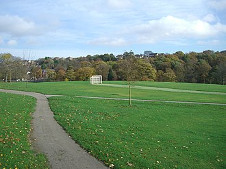 Firth Park (public park) - The park seen from the Vivian Road entrance with Hinde Common Wood in the background