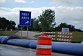 Flooded Road, Medina rest area exit sign and barriers.jpg