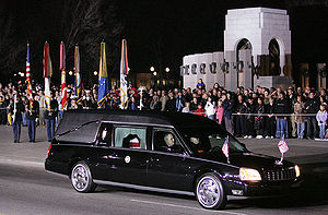 The hearse carrying the casket of former Presi...