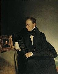 Der Maler Franz Wipplinger, das Miniaturporträt seiner verstorbenen Schwester betrachtend