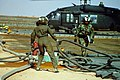 Fuel handling personnel moving fuel lines, 101st Airborne Division Rapid Refuel Point.jpg