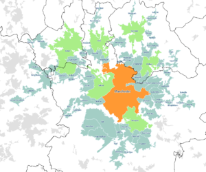 A map of the Greater Manchester Built-up Area according to the 2011 census, with Travel to Work Areas overlaid. Manchester is highlighted in orange