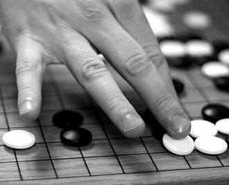 Game of go - placing a white stone