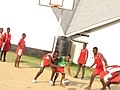 Girl Nyakasura School exploring the fun in basketball.jpg