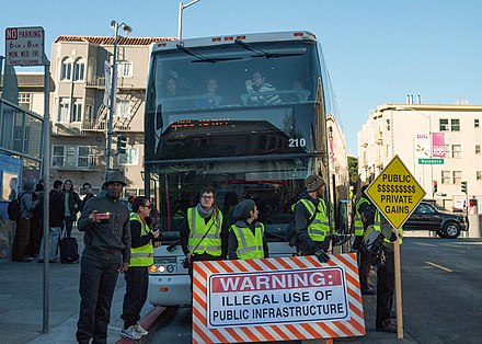 San Francisco activists protest privately owned shuttle buses that transport workers for tech companies such as Google from their homes in San Francisco and Oakland to corporate campuses in Silicon Valley. Google bus protest.jpg