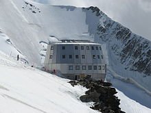 large mountain hut on a snow-covered mountainside