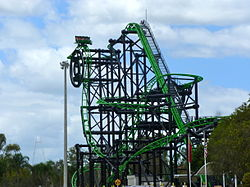 Green lantern coaster wikipedia movie world car parking lot one of the trains can be seen near the top of the ride about to proceed down the first drop gumiabroncs Image collections