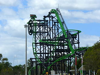 Green Lantern Coaster - Green Lantern Coaster from the Warner Bros. Movie World car parking lot. One of the trains can be seen near the top of the ride about to proceed down the first drop.