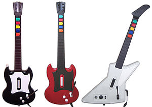 Guitar Hero - The controllers bundled with Guitar Hero releases (from left to right): Gibson SGs for Guitar Hero and Guitar Hero II (PlayStation 2) and Gibson Explorer for Guitar Hero II (Xbox 360) and Guitar Hero III: Legends of Rock (PC)