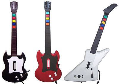 The controllers bundled with Guitar Hero releases (from left to right): Gibson SGs for Guitar Hero and Guitar Hero II (PlayStation 2) and Gibson Explorer for Guitar Hero II (Xbox 360) and Guitar Hero III: Legends of Rock (PC) Guitar Hero series controllers.jpg