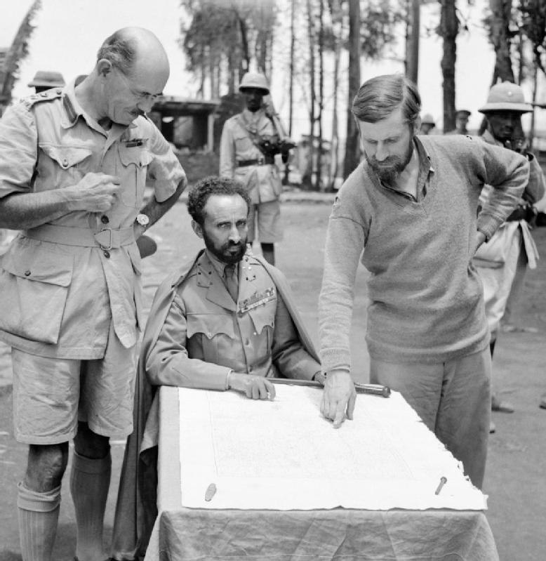 Haile Selassie, Emperor of Abyssinia, with Brigadier Daniel Arthur Sandford (left) and Colonel Wingate (right) in Dambacha Fort, after it had been captured, 15 April 1941. E2462