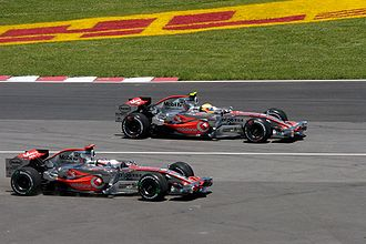 2007 Canadian Grand Prix - Lewis Hamilton leads at the start of the race, whilst Fernando Alonso runs wide at the first corner.