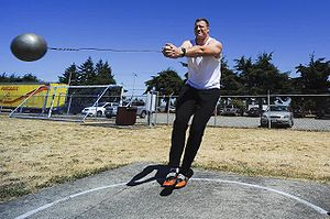 English: Hammer thrower Mike Mai practices at ...