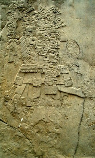 """La Mojarra Stela 1 - Left side image of La Mojarra Stela 1, showing a person identified as """"Harvester Mountain Lord""""."""