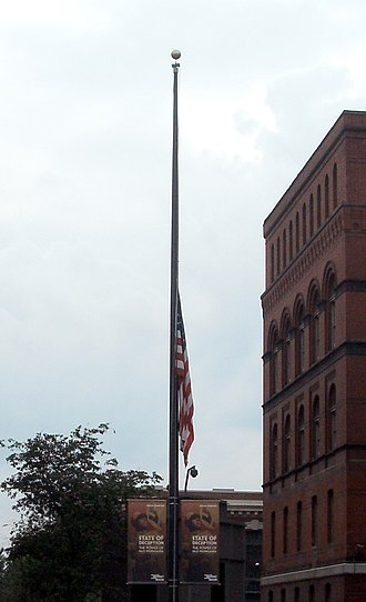 United States Holocaust Memorial Museum shooting - The day after the shooting, the Holocaust Museum's flag flew at half-staff in memory of the murdered guard, Stephen Tyrone Johns.