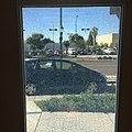 Honda fit seen through broken safety glass window.JPG