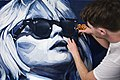Ian Berry working on the Debbie Harry Portrait all made in deinim.jpg