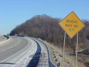 Black ice - Warning sign for bridge on US turnpike