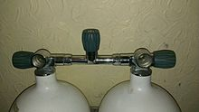 Two 300 bar scuba cylinders connected by an isolating manifold
