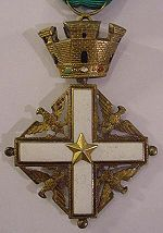 A white Greek cross embellished in the four principal angles with gold eagles displayed and surmounted by a gold crown of four towers.