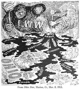 "Joseph James Ettor - Employers feared ""Ettorism"". This 1913 anti-union cartoon from The American Employer depicts an IWW organizing drive as ""a volcano of hate stirred into active eruption at Akron, by alien hands, which pour into the crater the disturbing acids and alkalis of greed, class hatred and anarchy. From the mouth of the pit rise poisonous clouds of suspicion, malice and envy to pollute the air, while from the cracked and breaking sides of the groaning mountain flow streams of lava of murder, anarchy and destruction, threatening to engulf in their path the fair cities and fertile farms of Ohio."""