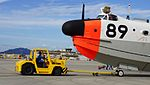 JMSDF US-1A(9089) towed by 5t class tractor(MC-0514) at Iwakuni Air Base September 14, 2014 01.jpg