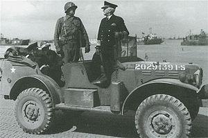 James Edward Wharton - Wharton (left), escorts Admiral Harold Stark on Utah Beach.