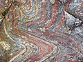 Jaspilite banded iron formation (Soudan Iron-Formation, Neoarchean, ~2.69 Ga; Stuntz Bay Road outcrop, Soudan Underground State Park, Soudan, Minnesota, USA) 1 (19199008986).jpg