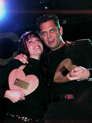 Jewel De'Nyle - De'Nyle and Nacho Vidal holding their XRCO Award trophies for Best Male-Female Sex Scene in 2001