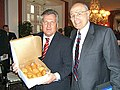 John Dingell presents Polish President Aleksander Kwasniewski with paczki.jpg