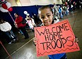 John Parker Jr., 4, proudly displays a sign celebrating his father's return.jpg