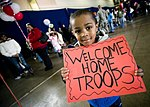 John Parker Jr., 4, proudly displays a sign celebrating his father's return.jpg