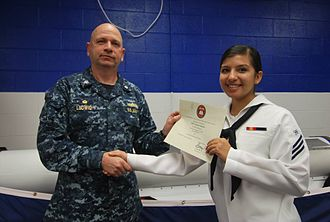 Electronics technician (United States Navy) - An Electronics Technician (ET) Seaman receiving a certificate upon graduating from ET 'A' School.