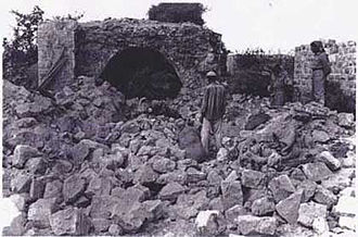 Unit 101 - A resident of Qibya at the ruins of his house after the attack by Israeli forces in October 1953.