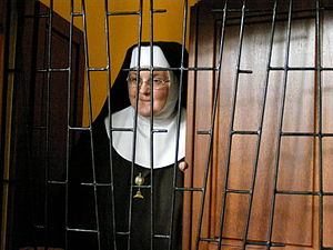 Enclosed religious orders - An enclosed nun.