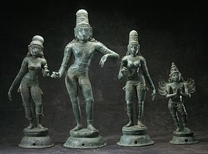 Rukmini - Krishna with his two principal queens. (From left) Satyabhama,  Krishna, Rukmini and his vahana Garuda.