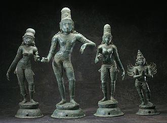 Satyabhama - Krishna with his two principal queens.(From left) Rukmini, Krishna, Satyabhama and his vahana Garuda.
