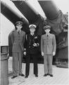 L to R, Lt. George Elsey, Captain James Vardaman, and ship's clerk Edwin L. Hoying stand on the deck of the U. S. S.... - NARA - 198728.tif