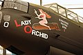 """Lancaster FM136 nose art """"Lady Orchid"""" at Aero Space Museum of Calgary Flickr 6201758065.jpg"""