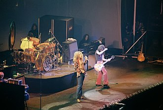 "Trampled Under Foot - Led Zeppelin perform ""Trampled Under Foot"" in Chicago, January 1975. Jimmy Page is using a wah-wah pedal."