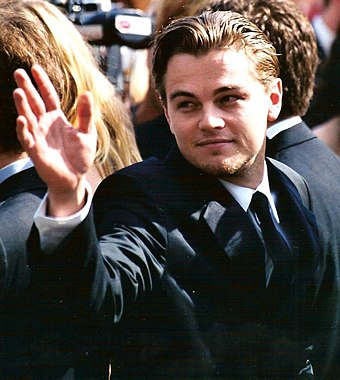 "Leonardo DiCaprio (pictured) was paired opposite Winslet in Titanic (1997). A journalist for Vanity Fair labelled them ""Hollywood's most iconic screen couple"" since Humphrey Bogart and Ingrid Bergman. Leonardo DiCaprio 2002.jpg"