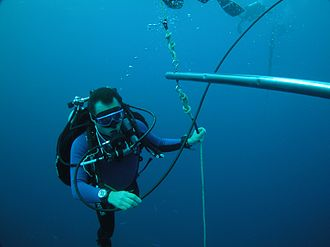 Decompression theory - Scuba diver decompressing at a planned stop during ascent from a dive