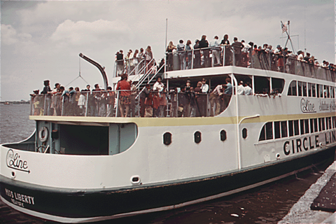 Tourists aboard a Circle Line ferry arriving at Liberty Island, June 1973 Libertyferry.png