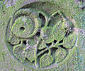 Lichened Carving - St. Peter's Churchyard - geograph.org.uk - 1582591.jpg